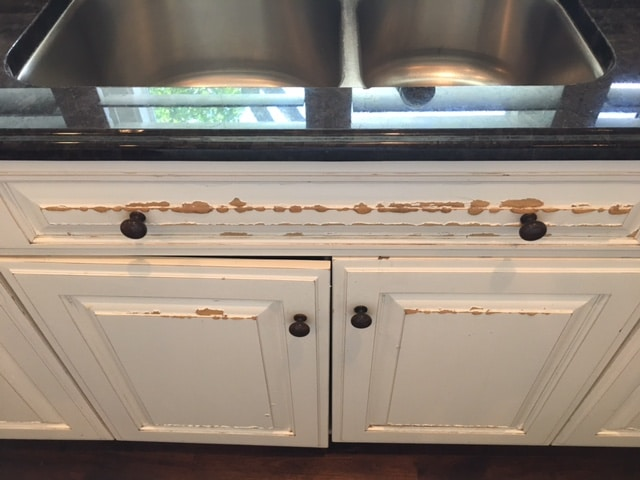 water damaged cabinet - top 3 problems with painted cabinets