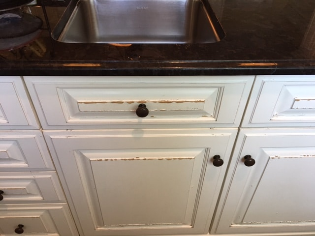 How to Fix Water Damaged Cabinets & What to Look For ...
