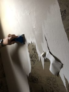 scraping off wallpaper and adhesive