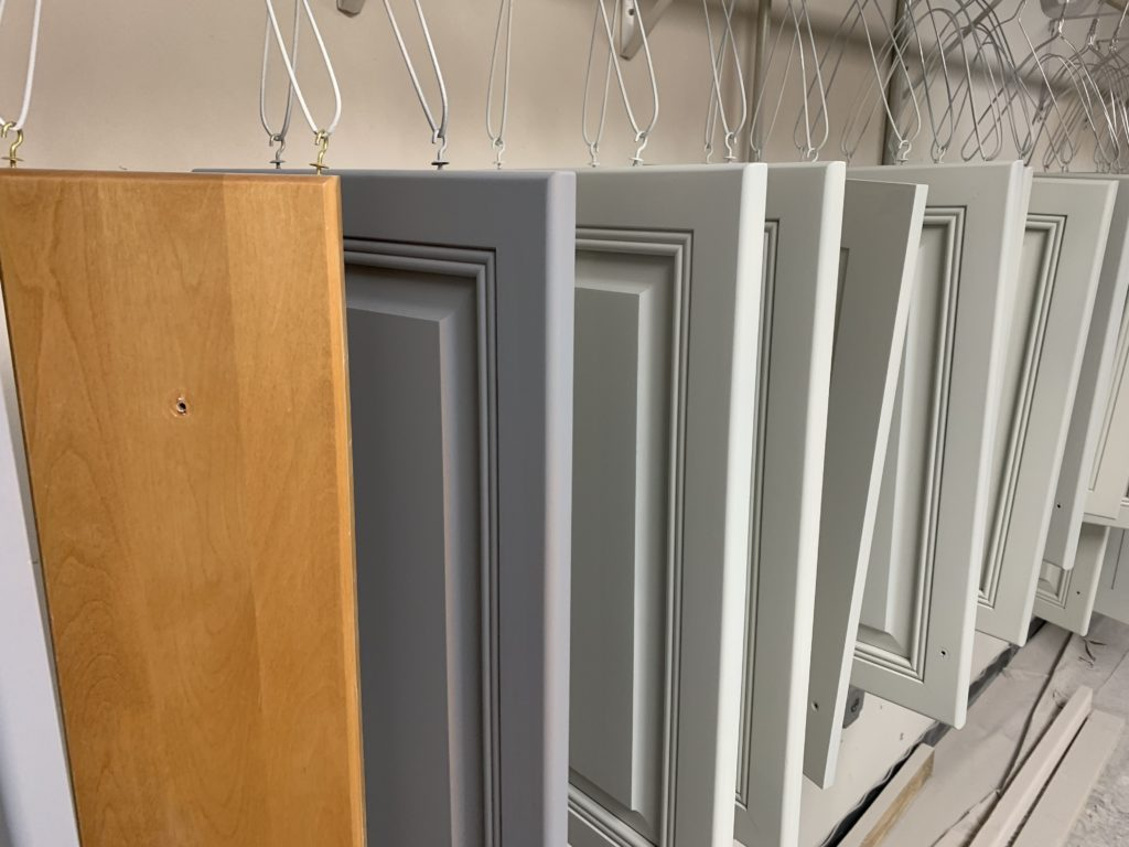 maple cabinets being painted white