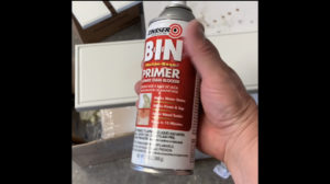spot primer for how to fix holes in cabinet doors