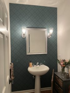 accent wallpaper in powder room